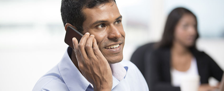 22240182 - portrait of an indian business man using a smartphone