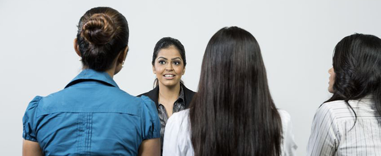16771849 - three indian colleagues from hr department interview a female applicant